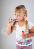 Young  girl blow out soap bubbles Stock Images