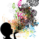 Young girl blowing abstract floral Royalty Free Stock Photo