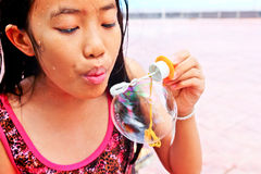 Young girl blowing Stock Images