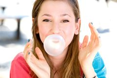 Young girl blowing bubble gum Royalty Free Stock Images