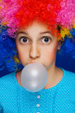 Young girl blowing bubble gum balloon Royalty Free Stock Images