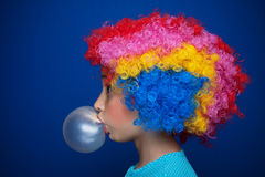 Young girl blowing bubble gum balloon Stock Photos