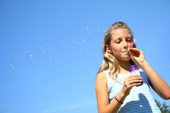 Young girl blowing bubbles Royalty Free Stock Images