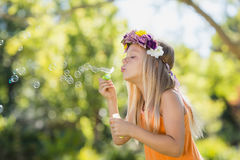 Young girl blowing bubbles through bubble wand Stock Image