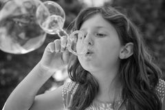 Young girl blowing bubbles Royalty Free Stock Photography