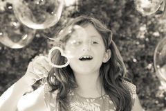 Young girl blowing bubbles Stock Image