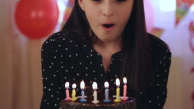 Young girl blowing candles on birthday cake stock video footage