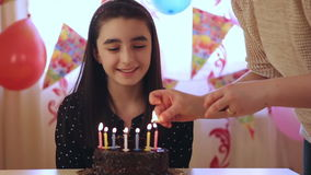 Young girl blowing candles on birthday cake stock footage