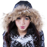 Young girl blowing cold snow Stock Images
