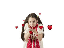 Young girl blowing hearts away Royalty Free Stock Images
