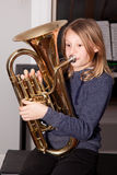 Young girl blowing horn Stock Photo