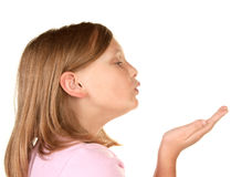A young girl blowing a kiss Stock Photos