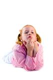 Young girl is blowing a kiss Royalty Free Stock Image
