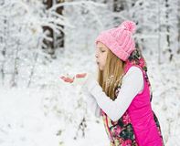 Young girl blowing magic snow Royalty Free Stock Photos
