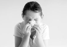 Young girl blowing nose stock image