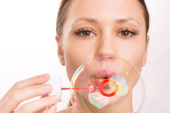 Young girl blowing out a soup bubble Stock Photography