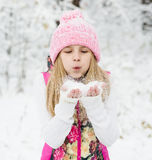 Young girl blowing snow Royalty Free Stock Photography