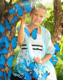 Young girl with blue butterflies Stock Photo