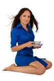 Young girl in blue dress with cup of coffee. Royalty Free Stock Images