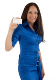Young girl in blue dress with plastic card. Stock Photos