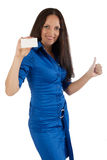 Young girl in blue dress with plastic card. Stock Image