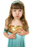 Young girl in a blue dress puff out cheeks Royalty Free Stock Photos