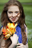 Young girl in a blue dress relaxing in spring park Royalty Free Stock Photo