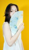 Young girl and blue fan Royalty Free Stock Images