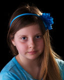 Young girl in blue with flower in her hair Stock Photography