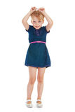 Young girl in blue jeans dress Royalty Free Stock Photos