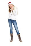 Young girl with blue jeans, white shirt and boots standing posin Stock Image