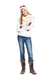 Young girl with blue jeans, white shirt and boots standing posin Stock Images