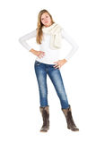 Young girl with blue jeans, winter jacket and boots standing pos Royalty Free Stock Photography