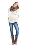 Young girl with blue jeans, winter jacket and boots standing pos Royalty Free Stock Photo