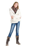 Young girl with blue jeans, winter jacket and boots standing pos Royalty Free Stock Image