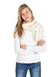 Young girl with blue jeans, winter jacket and boots standing pos Stock Images