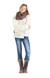 Young girl with blue jeans, winter jacket and boots standing pos. Ing over white background Royalty Free Stock Photos