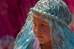 Young Girl in Blue Lace Headdress. A young girl wearing a blue lace headdress, participating in the Pase del Niño parade, Cuenca, Ecuador, December 24, 2013 Royalty Free Stock Images