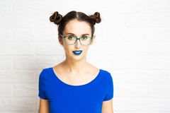 Young Girl with Blue Lips and Two Hair Buns. Royalty Free Stock Photo