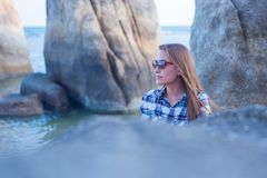 Young girl on blue sea background. Tropical country.  Royalty Free Stock Photo