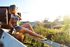 Young girl in blue shorts on metal constr Stock Photography