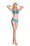 Young girl in blue swimsuit standing and smiling royalty free stock image