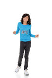 Young girl with blue top dancing Stock Photography