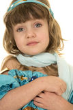 Young girl in a blue top and scarf close looking Stock Image