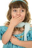 Young girl in a blue top and scarf hand over mouth Stock Image