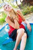 Young girl posing. Portrait of a young girl smiling in the boat in park Stock Photo