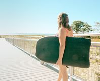 Young Girl with a body board near ocean stock images