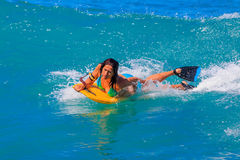 Young girl body surfing in Waikiki Beach Hawaii Stock Photo