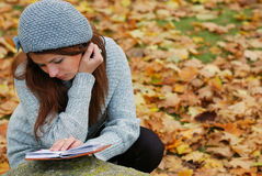 A young girl with a book. In the park Royalty Free Stock Images