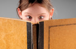 Young girl and book Royalty Free Stock Photography